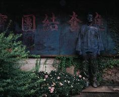 Liu Bolin ~ The Invisible Man    This guy paints himself and then takes a picture. He does not use photoshop.