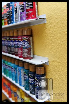 Simple, compact, and inexpensive storage using T braces for hanging ceiling. Great for paints, Stickles, ink refills and more!