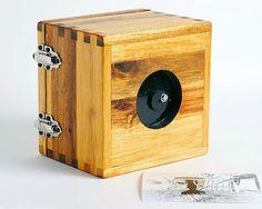 make your own pinhole camera: http://www.kodak.com/ek/US/en/Pinhole_Camera.htm