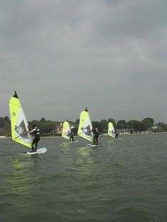 Stag Do meets HenParty out on the water at the Poole Windsurfing School - hope everyone was listening about how to steer! #poolewindsurfing #windsurfinglessons #stagdowindsurfing #henpartywindsurfing