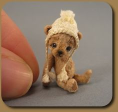 Teeny tiny teddy bear. How do they do that? How do they make that hat?