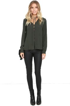 The Meditation Retreat Charcoal Grey Blouse is perfect for balancing your mind and your wardrobe! Gauzy woven fabric forms this collarless blouse with a tying neckline and full loop button placket. Darted, relaxed-fit bodice ends in a slight high-low hem with notched sides. Long sleeves with button cuffs.