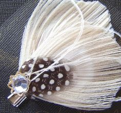 Beautiful white peacock clip...might be easier than bobby pins