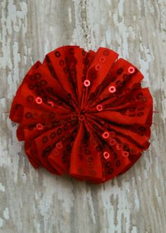 """This sparkly fabric flower is perfect for crafting fun headbands, hair clips, and more! They are made of pleated sequin embellished fabric in a circular shape. They are about 2.5"""""""" across and include"""