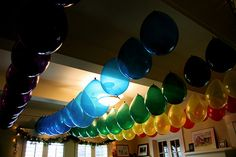 One of the best party decorating ideas ever--hanging balloons, LOTS of balloons Note: You'll definitely need to buy a balloon pump for this project. String Balloons, Hanging Balloons, Balloon Ceiling, Rainbow Balloons, Up Balloons, Balloon Garland, Balloon Decorations, Balloon Ideas, Ceiling Decor