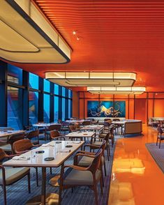 """""""Vivid orange flooring cuts a path through the dining room while ceiling panels are inspired by the persimmons found in local markets."""" via // // Voyages by Alain Ducasse // Eric Laignel Home Decor Online, Home Decor Store, Home Decor Items, Living Room Decor, Dining Room, Restaurant Lighting, Ceiling Panels, Unique Home Decor, Home Look"""