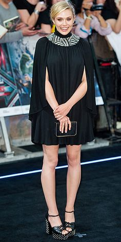 Last Night's Look: Love It or Leave It? | ELIZABETH OLSEN | in a Saint Laurent cape dress with an embellished neckline, gold-trimmed Salvatore Ferragamo clutch and studded shoes at The Avengers: Age Of Ultron European premiere in London.
