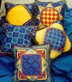 beautiful geometric painted fabric pillows by www.pamdesign.com.