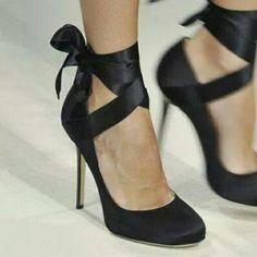 Black satin bow pumps.