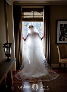Bride in window  |  Long veils  |  Bridal portraits  |  Aislinn Kate  |  Wedding photos  I  Pensacola Wedding Photographer