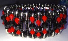 This beautiful bracelet was custom made with stainless steel safety pins, a d black/red seed beads, the safety pins measures 1 inch, each safety pin has been pinched closed to prevent opening and has been strung on stretchy cord to fit most wrist sizes, it is comfortable, durable and easy to put ...