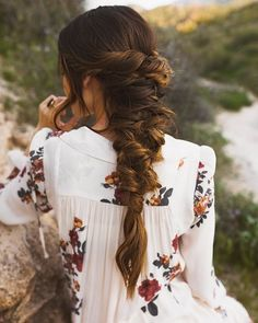Caroline's gorgeous creation is perfect for the romantic bride. The style mixes a loose fishtail braid with random twists for a relaxed appearance. Finish the look by bringing out loose strands of hair to the face.