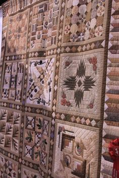 A taupe quilt that is a beauty!  Someday I'll do this!  So beautiful!