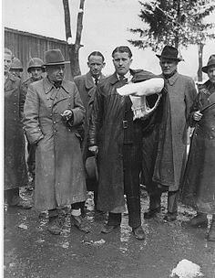 Magnus von Braun, two U.S. soldiers, Walter Dornberger, Herbert Axster, Wernher von Braun, Hans Lindenberg, and Bernhard Tessmann after surrendering to the Allies in 1945. Operation Paperclip – Rocketry. From Wikipedia.