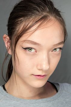 I love winged cat eye liner so much! Style.com
