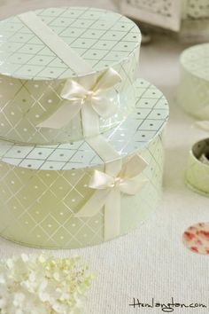As your party begins, 2 pretty boxes with little bows will be given to you. j