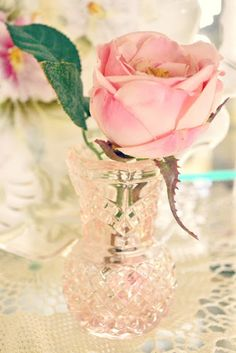 Pink depression glass vase with single pink rose
