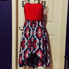 Hi Low Dress Festive Red, White, & Blue high low dress from Charming Charlie's.   Absolutely adorable worn with a jean jacket over it or alone with a blue or white statement necklace!  Adjustable arm straps!  Worn once!!!! Charming Charlie Dresses High Low