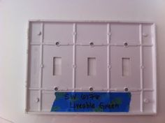 Write paint color and brand on painter's tape and stick to back of room's light switch cover