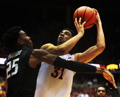 Iowa State's Georges Niang looks for a shot around Kansas State's Wesley Iwundu at Hilton Coliseum on Saturday. Photo by Nirmalendu Majumdar/Ames Tribune  http://amestrib.com/sports/men-s-basketball-cyclones-look-team-prohm-wants-win-over-wildcats