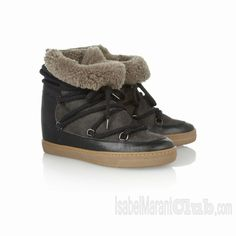 "Isabel Marant's leather and suede ankle boots feature a clever concealed wedge heel, giving you height but keeping a casual aesthetic. The shearling lining will keep you warm when temperatures drop. Includes alternate red laces. Approximately 2.75"" heel"