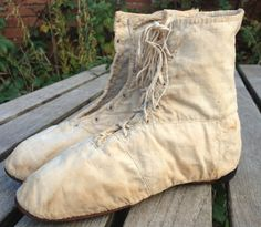 "c1810 beige canvas boots. OP says: ""They are front-lacing. Made for everyday wear out of canvas outer and linen inner, definitely not fine boots. Straight soles and nailed heels. Notice the real mud stains around the base! I know that late Victorian bathing boots look similar, but I think these are 'right' for the Regency era."""