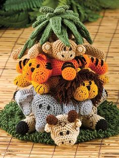 Into the Jungle Crochet Pattern via Annie's ~ each animal is a crocheted ring with graduated sizes. They stack onto the cone shaped palm tree (top comes off)