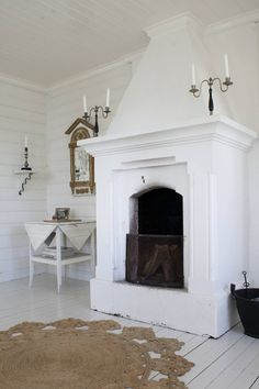 Love the regal-ness of this, but love even more that it looks like that fireplace is actually used.