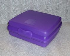 """Tupperware Purple Sandwich Keeper by Tupperware. $11.99. Dishwasher safe. Measures approximately 5 1/2"""" x 5"""" x 2"""".. Purple in color. Tupperware Sandwich Keeper. Keeps sandwich fresh and from getting crushed in the lunch box, back pack, or gym bag.  Will even fit in the brief case or purse.. Tupperware purple sandwich keeper.  Hinged, one-piece construction, keeps sandwich fresh and from getting crushed in the lunch box or bag.  Measures approximately 5 1/2"""" x 5""""..."""