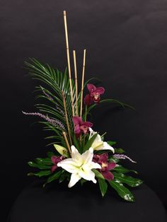 Contemporary!! White Lilys and Burgundy Cymbidium Orchids