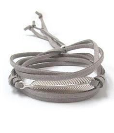 Gray Suede Feather Wrap Bracelet Faux gray suede wrap bracelet with silver textured leaf focal charm. Adjustable bracelet.
