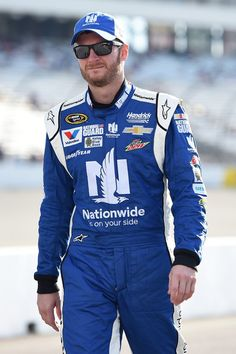 Dale Earnhardt Jr., driver of the #88 Nationwide Insurance Chevrolet, walks on the grid prior to qualifying for the NASCAR Sprint Cup Series Federated Auto Parts 400 at Richmond International Raceway on September 5, 2014 in Richmond, Virginia.