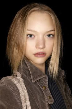 Gemma Ward. Previously I didn't use to like her face much, now she turned out to be a real beauty to me, but not as human average beauty. Her face is out of this world: her delicate facial features, the sullen mouth, the smooth and perfectly fair skin, the big, beautiful, blue slanted eyes and the golden hair... she looks like a doll, or a beautiful alien.
