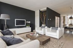 Light Fabric Sofa With Dark Walls, Image credit from styleguide.nl