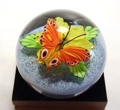 Glass Paperweights at Art Glass by Gary Gallery - butterfly on flower. Amazing detail and perfect scale. Love it!