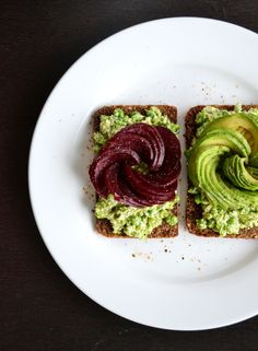 Avocado rose and beetroot rose on a bed of pea, feta and mint on rye bread, yum!