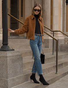 """Brown pile furry jacket with ring zipper and side pockets Made by us 100% polyester Length 25"""" Model is wearing a size small and model's height is 5.9"""""""