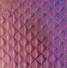 Repetitive line designs in a grid: Quilting by Cindy Needham: Class Samples