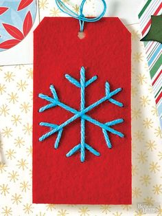 No two are exactly alike! To make a snowflake tag, poke six clusters of  holes around a felt tag. String contrasting yarn through the holes, and secure in the back with hot glue.