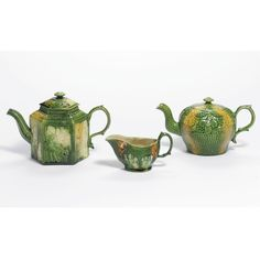 TWO STAFFORDSHIRE LEAD-GLAZED CREAM-COLORED TEAPOTS AND COVERS AND A SMALL SAUCEBOAT CIRCA 1760-65