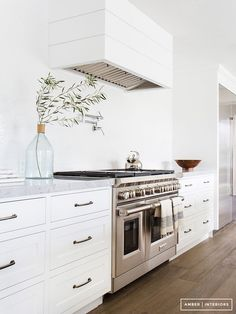 Shiplap Kitchen Hood - Design photos, ideas and inspiration. Amazing gallery of interior design and decorating ideas of Shiplap Kitchen Hood in kitchens by elite interior designers. Kitchen Hoods, New Kitchen, Kitchen Dining, Kitchen Decor, Kitchen Cabinets, Kitchen White, White Cabinets, Shaker Cabinets, Upper Cabinets
