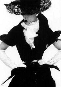 Lisa Fonssagrives, in Lilly Dache hat - April 1950 - New York - Vogue - Photo by Irving Penn