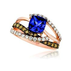 Blue blue blue berry tanzanite ring accented with vanilla and chocolate diamonds.  Marshall Jewelry