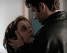 """Gif of deleted kiss between Mulder and Scully from Memento Mori.  """"There were obvious reasons for deleting the first kiss on the lips between Mulder and Scully. It wasn't scripted and the actors decided to give it a try."""" - Chris Carter"""