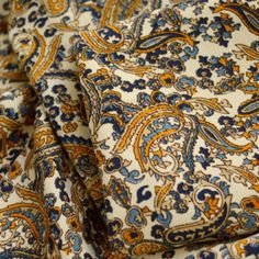Here we have a selection of beautiful paisley dress fabrics which are wide. These fine polyester crepes fabrics are perfect for summer dresses, blouses & skirts. This one is a mustard & Blue paisley print on an ivory background. Fabric Yarn, Crepe Fabric, 1950s Fashion Dresses, Vintage Dress Patterns, Teal And Grey, Royal Blue Color, Paisley Dress, Blouse And Skirt