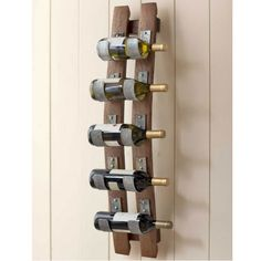 A rustic five bottle wine storage rack that is handcrafted from two genuine reclaimed wooden wine barrel staves and uses the metal barrel rings to securely hold the bottles horizontally. Wine Glass Rack, Wood Wine Racks, Wine Rack Wall, Iron Wine Rack, Wine Barrel Crafts, Wine Barrel Rings, Wine Barrels, Wine Cellar, Arte Bar