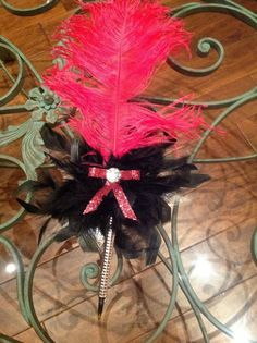 Fun and fluffy functioning feather pen by funinfunction on Etsy, $12.99