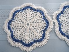 Small crocheted doily with blue accents.
