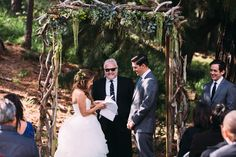 My father designed and created our arch from scratch and my grandmother and aunt decorated it with flowers. My Tio did a fantastic job officiating our wedding & looked so suave doing it Wedding In The Woods, Our Wedding, Wedding Looks, My Father, Aunt, Wedding Dresses, Flowers, Photography, Fashion