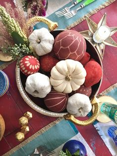 Create a festive Fall centerpiece with floral fillers and mini pumpkins and layer in a metal bowl from HomeGoods. Setting the table for a dinner party has never been more colorful or easy! Sponsored Happy By Design